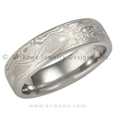 Platinum Mokume Band with a Light Etch and Micro-edge - This mokume gane is made up of layers of three different metals: platinum, sterling and 14k palladium white gold. This extremely low contrast mokume needs to have an etch to best accentuate the contrast of colors of the metals. Our most subtle mokume for your wedding band. If you like a rugged look, but prefer a limited color contrast, the heavy etched Platinum Mokume Gane wedding band may be just for you. You will still have the…
