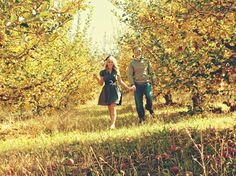 engagement-couple-walking-apple-orchard-81469