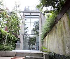 The rear of the home is a wall of glass, allowing the indoors to blend seamlessly with the backyard oasis.