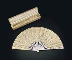 A JEWELLED TWO-COLOUR GOLD-MOUNTED MOTHER-OF-PEARL AND GUILLOCHÉ ENAMEL FAN  MARKED FABERGÉ, WITH THE WORKMASTER'S MARK OF MICHAEL PERCHIN, ST PETERSBURG, 1899-1903