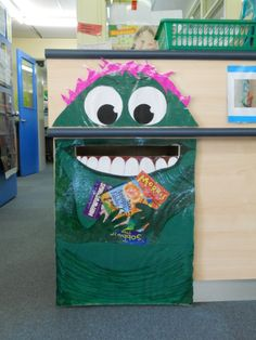 """Reminding students to """"Feed the Monster"""", to return their library books. Thanks to my Friday girls for their help in making our monster."""