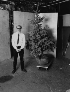 """Unknown photographer, 'Andy Warhol and his Christmas tree in the Factory,' 1964"""" (The Andy Warhol Museum)"""