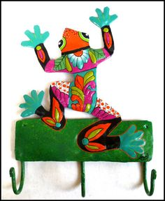 """Frog towel hook measures 8 1/2"""" x 12"""". Handcut from recycled steel oil drums and hand painted."""