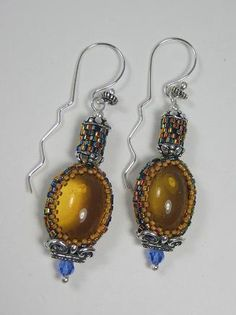 Amber Glass over bezeled with Dichroic Seed Beads