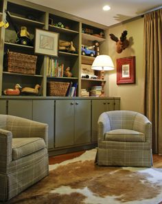 love this playroom...the stuffed animal moose head, the animal skin rug...very manly feeling...would be great for little boys