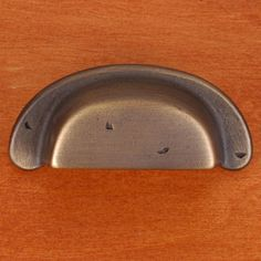 This antique english finish cabinet/drawer cup pull with distressed heavy rustic design from RK International is perfect for use on cabinet doors and drawers capable of accepting a mounted pull.