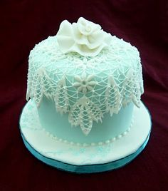 Suspended lacework on a cake. The precision and confidence needed to do this kind of work are staggering.