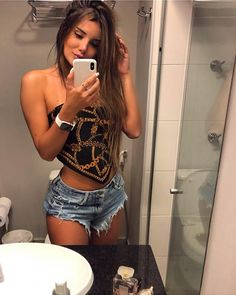 Image may contain: 1 person, standing, phone and selfie Sexy Jeans, Sexy Shorts, Music Festival Outfits, Girl Fashion, Fashion Outfits, Brazilian Girls, Models, Hot Pants, Look Cool