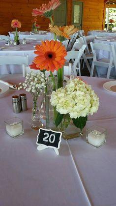 Assorted bottles centerpiece  Blush Custom Weddings