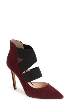 An exaggerated topline amplifies the modern sophistication of a pointy-toe pump…