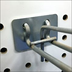 This Pegboard Scan Hook Protector Plate is an aftermarket accessory not often seen. It actually adds to the visual presentation as well as protects the. Hooks, Door Handles, Retail, Plates, Decor, Point Of Purchase, Door Knobs, Licence Plates, Dishes