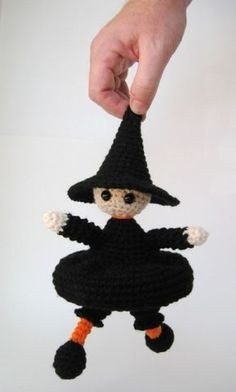 This Sweetest Lil Witch Amigurumi Crochet Pattern makes a little trick-or-treater Witch amigurumi doll. It comes with instructions for her personalized trick-or-teat bag! She's not very traditional, but neither am I. My husband says she looks Tim Burton-ish. Sweetest Lil Witch Amigurumi | Free Crochet Pattern  https://simplycollectiblecrochet.com/2014/07/sweetest-lil-witch-amigurumi-crochet-pattern/