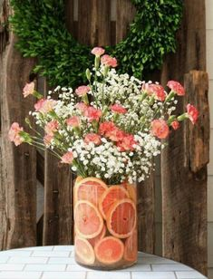 Wedding Flower Arrangements Quick tips for floral arrangements - DIY Fruit Floral Arrangement ideas that you can create in 10 minutes or less. Add a fresh bunch of flowers to your home decor. Fruit Flowers, Diy Flowers, Summer Flowers, Flowers Vase, Flowers Decoration, Table Flowers, Flower Ideas, Pink Carnations, Flower Bouquets