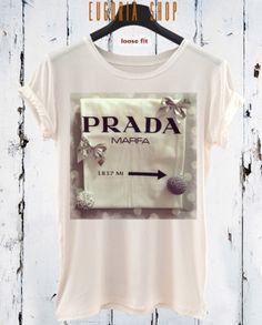Prada fashion pop art t-shirt, white t-shirt , Printed T-Shirt , cotton tshirt , eco print tshirt , loose tshirt , waisted shirt, short long sleeve tshirt, woman man tshirt