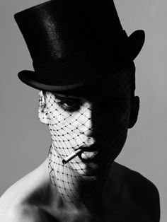 Male model wearing top hat with face veil