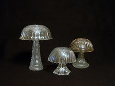 ReCreations In Glass makes garden art. Trio of Mushrooms made with repurposed glass. Glass garden art totems.. $39.00, via Etsy.