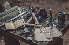 {Swords, some scripts, and a... beer mug? What for? - They said it's a merc's belonging.}