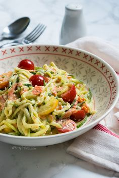 Paleo Smoked Salmon Courgette Carbonara - have a gluten free, dairy free dinner ready in 10 minutes with spiralized courgette / zuchinni in a creamy white sauce with smoked salmon and cherry tomatoes.