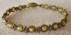 "Linda's Crafty Inspirations: Bracelet of the Day: Mingles Tweak #2 - Olive--11/0 seed beads Miyuki ""Dark Bronze"" (11-457D) 15/0 seed beads Miyuki ""Dark Bronze"" (15-9457D) 4mm druks ""Hurricane Glass Matte Light Olive/Red"" (BCP-74203)"