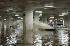 wakeboarders in a parking garage.