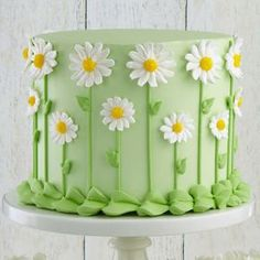 Fresh as a Daisy Cake Our favorite fresh-look flower, the daisy forms a fun covering for the sides of this cake. The centers are dusted with yellow sugar to add sparkle, making this cake a sensation at celebrations, indoors and out! Pretty Cakes, Cute Cakes, Beautiful Cakes, Amazing Cakes, Cake Decorating Tips, Cookie Decorating, Birthday Cake Decorating, Daisy Cakes, Flower Cakes