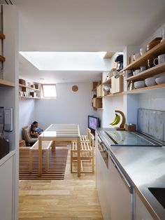 This house in Nada, Japan designed by Fujiwarramuro Architetects, is just 680 square feet (63 square meters). Located on a narrow lot in a downtown reside
