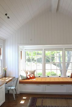V-groove white beadboard in Mark Reilly guest house, Remodelista like the cover on window seat Bead Board Walls, Bead Board Ceiling, White Beadboard, Interior And Exterior, Interior Design, Tongue And Groove Ceiling, Ship Lap Walls, Play Houses, Cob Houses