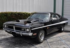 "This 1971 Dodge Dart Demon 340 fastback coupe is described as a ""show driver"" with just under 92k miles on the clock. It has a NOM 340 V-8 with a 4-speed manual transmission and its color combination is said to be rare. Demons and Dusters have great proportions, and with the right components they can be made to look as good as cars that cost much more. Find it here on eBay in Miami, Florida with bidding topping $19000."