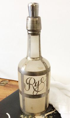 Partied with Jay Gatsby ! Yes, he is a fictional character, but this silver overlay glass Rye bottle was discovered near Long Islands Gold