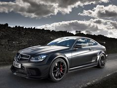 Mercedes Benz c63 amg black series ... OK Id drive it for a day .. cars arent my thing but it looks fun
