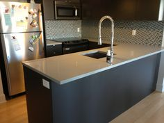 As certainly one of most sturdy choices, quartz counter tops are favored. Gray quartz counter tops give a watch catching … Gray Kitchen Countertops, Quartz Countertops Colors, Grey Kitchen Cabinets, Kitchen Tops, Modern Cabinets, Glass Kitchen, Granite Countertops, Black And Grey Kitchen, Black Kitchens