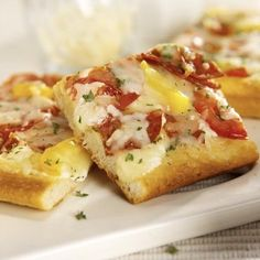 You can never pass up pizza, even during the holidays! Cheese Lovers Pizza Squares will leave your guests cheering for more. #RealDairyHolidays