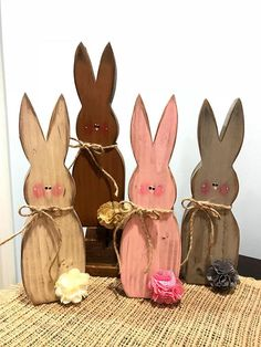 Colorful wooden bunnies for your spring and summer decor. These primitive, yet modern looking rabbits have been cut, sanded, painted, sanded again, then stained. All items may have some slight imperfections which only add to the character of each and every piece. Measures approx 11 1/4 x