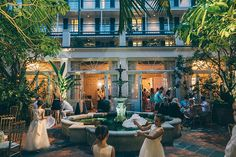 The Royal Sonesta Hotel courtyard at dusk in the heart of the French Quarter.   REAL WEDDING :: ANNETTE + CARLOS {Destination NOLA} http://www.neworleansweddingsmagazine.com/real-wedding-annette-carlos-destination-nola/  photo: Ardent Studio