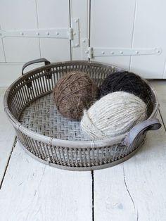wool decor balls in bamboo basket