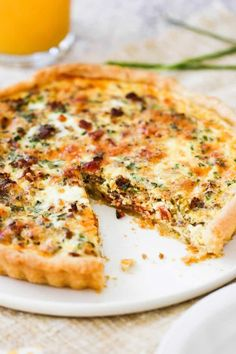 A breakfast quiche on a circular white platter with a slice missing and a glass of orange juice next to it. Quiche Recipes, Brunch Recipes, Breakfast Recipes, Egg Recipes, Pork Recipes, Seafood Recipes, Chicken Recipes, Sausage Quiche, Bacon Sausage