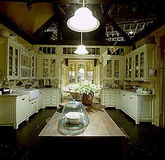 Shot of the Practical Magic Kitchen from the Aga wall, looking into the dining area across the work table.
