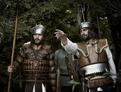 """Celtic aristocratic warriors: the one on the left wearing a montefortino helmet and an armour inspired to the handle's warriors of """"Filottrano baking tray"""". The one on the right wearing a leather armour too, and a montefortino helmet inspired to the """"Santa Paolina of Filottrano"""" type. By Teuta Senones Pisaurenses (www.pisaurus.it)"""