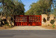 Red Driveway Gate, Olive Trees, Stone Wall  Gates and Fencing  Landscaping Network  Calimesa, CA
