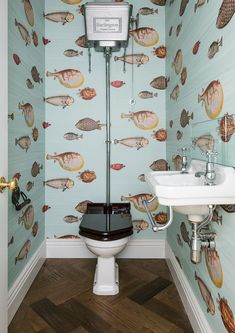 smallest room can be stylish Fishbowl: A cloakroom design by Grand Design London featuring Cole and Son's Fornasetti wa.Fishbowl: A cloakroom design by Grand Design London featuring Cole and Son's Fornasetti wa. Wallpaper Toilet, Small Bathroom Wallpaper, Fish Wallpaper, Wallpaper Ideas, Cloakroom Wallpaper, Kitchen Wallpaper Design, Quirky Wallpaper, Coral Wallpaper, Feature Wallpaper