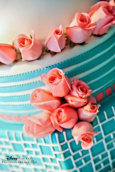 Rosebuds and mismatched layers of aqua, white and pink added to the sweetness of this Disney wedding cake