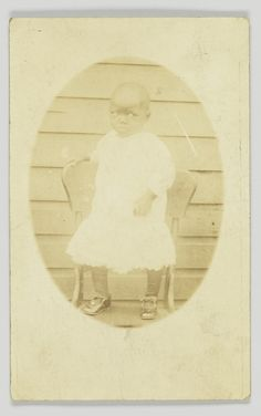 Photographic postcard featuring an oval portrait of a young child