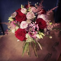 Red roses and pink rose wedding bouquet www.tippettsflorist.com