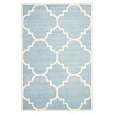 Artfully hand-tufted, this wool rug sports an exotic quatrefoil print in blue and ivory. Team with white furniture and pastel accents for a feminine bedroom ...