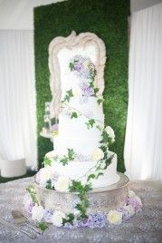 Soft and whimsical cake with a beautiful boxwood background