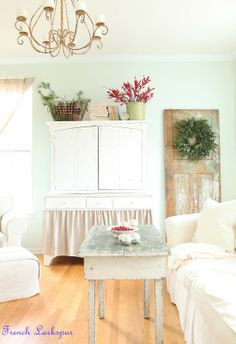 French Larkspur: totally obsessed. love the red berries against the wall, the door with the wreath, the skirted armoire. the WHITE. ugh. one day....