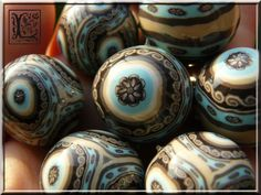 By Lolo60W.  Site has tons of polymer clay beads with many swirl beads