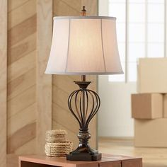 This table lamp design features a cut corner square base which is echoed by the shape of the neck