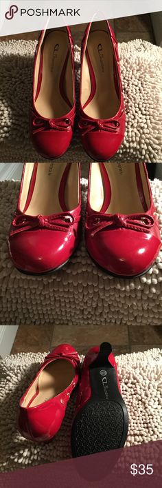 CL Laundry RED HEELS NWOT FUN AND FLIRTY CANDY APPLE RED HEELS.  Make these pop with a pair of jeans or a cute a-line skirt.  There are few minor scratches because they where in the bottom  of my closet without a box.  Hardly noticable.  I love reasonable offers.  Thank you for checking out my closet. CL LAUNDRY Shoes Heels