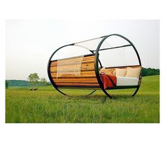 OMG! A rocking bed. Yes! (though, I'd be afraid of rolling all the way around...)